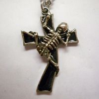 Skeleton Climbing Cross Necklace